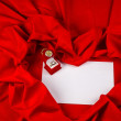 Love card with diamond ring on a red fabric — Stock Photo #39567685