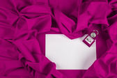 Love card with diamond ring on a purple fabric — Stock Photo