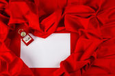 Love card with diamond ring on a red fabric — Stock Photo