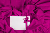 Love card with heart and ribbon on a purple fabric — Stock Photo