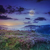 Cold fog on hot sunrise in mountains with moon — Stok fotoğraf