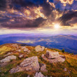 Light on stone mountain slope with forest at sunset — Stock Photo #40808301