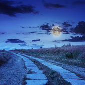 Road of concrete slabs uphill to the night sky — Stock Photo