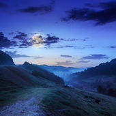 Cold fog on cold night in mountains — Stock Photo