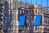 New window  reflects building — Stock Photo