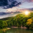 Calm mountain river on a cloudy summer sunset — Stock Photo