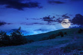 Path on hillside meadow in mountain at night — Stock Photo