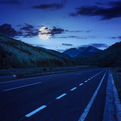Asphalt road in mountains at night — Stock Photo