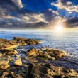 Sea wave breaks about boulders at sunset — Stock Photo #48476175