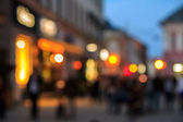 Crowd  moving on old city night street blurred — Stock Photo
