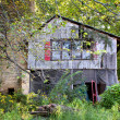 Stock Photo: Dilapidated River House