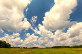 Puffy Cumulus Clouds Over the Countryside — Stock Photo