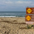 Sign Warns of Rip Currents — Stock Photo