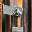 Stock Photo: Closed Wood Gate Protected by Strong Lock