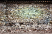 Crumbling Brick Wall Background and Backdrop — Stock Photo