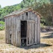Stock Photo: Dilapidated Outhouse