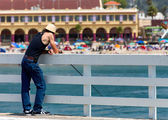 Man Fishes From Wharf — Stock Photo