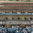 Stock Photo: No Trespassing on Railroad Tracks