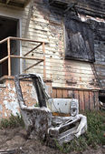 Ruined Chair Outside Burned Building — Stock Photo