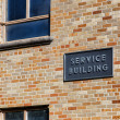 Stock Photo: Service Building Marked with Sign