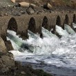 Stock Photo: Raging Floodwater Drains Trhough Culvert Pipes