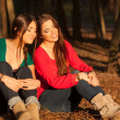 Young girlfriends playing on a park - Stock Photo