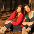 Young girlfriends playing on a park — Stock Photo