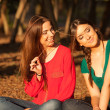 Stock Photo: Young girlfriends playing on a park