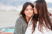 Young beautiful girlfriends portrait kiss — Stock Photo