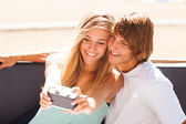 Young beautiful couple taking selfportrait — Stock Photo