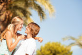 Young romantic beautiful couple enjoying on a walkside — Stock Photo