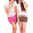 Young couple female friends laughing on white — Stock Photo #25183673