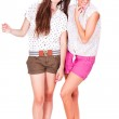 Young couple female friends laughing on white — Stock Photo #25183689