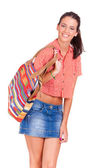 Young beautiful women walking with a colorful bag — Stock Photo