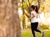 Young beautiful woman jogging — Stok fotoğraf