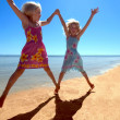 Two Girls having fun on a tropical beach — Stock Photo