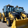 Two new bulldozers on a show-window — Stock Photo