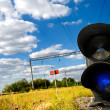Landscape with a railway traffic light - Stock Photo