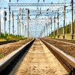 Long view of railway with heat haze - Stock Photo
