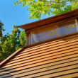 Wooden roof of a small house of rest - Stock Photo