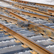Close up a rail and railway cross ties - Stock Photo