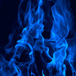Fire stylized in dark blue colour — Stock Photo
