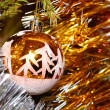 Royalty-Free Stock Photo: Xmas ball hanging on fir tree