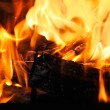 Stock Photo: Wood burns on fire