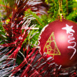 Red xmas ball hanging on pine twig — Stock Photo #12117735