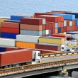 Truck transports container to warehouse near sea — Stock Photo #12117958