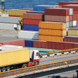 Stock Photo: Truck transports container to warehouse near sea