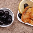 Stock Photo: Fried fish with a lemon and olives