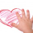 The children's hand is located in heart drawing — Stock Photo