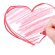 Childrens hand with pencil draws the heart — Stock Photo